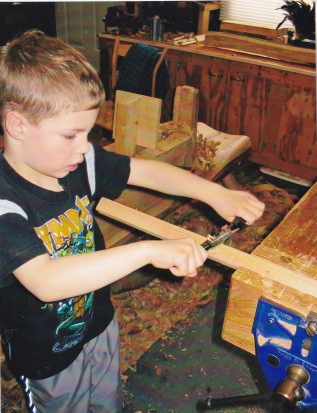 Noah getting to know the spokeshave.